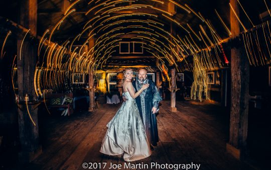 Bride and groom pose for a photo inside the Stone Mountain Art Center