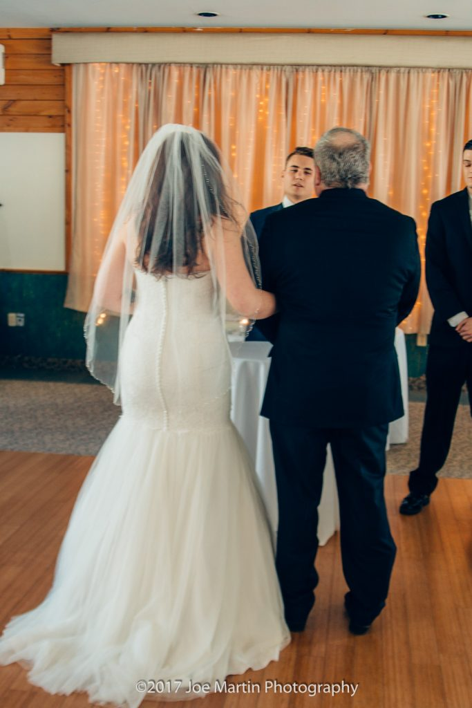 father of the bride stand with his daughter at the altar