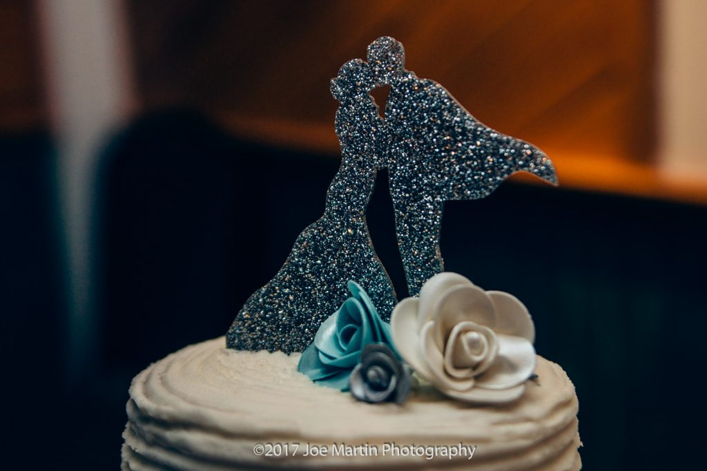 cake topper of a bride and groom kissing.