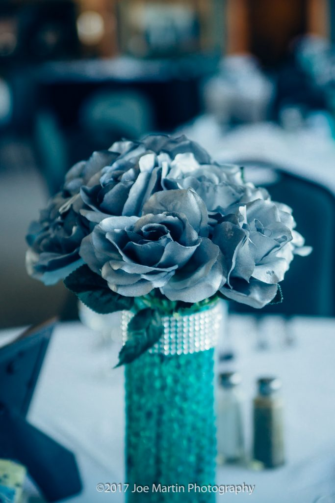 Flowers on this wedding table detail
