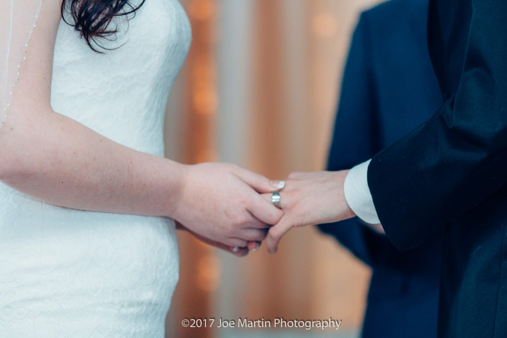 wedding rings being exchanged at a wedding
