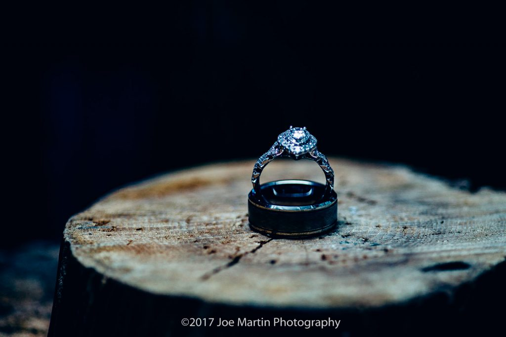 wedding rings on a log in a detail photo