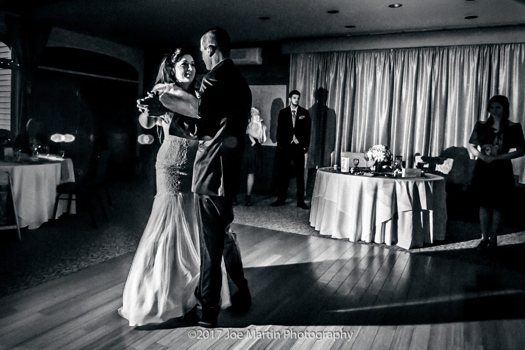 black and white photo of a wedding day first dance