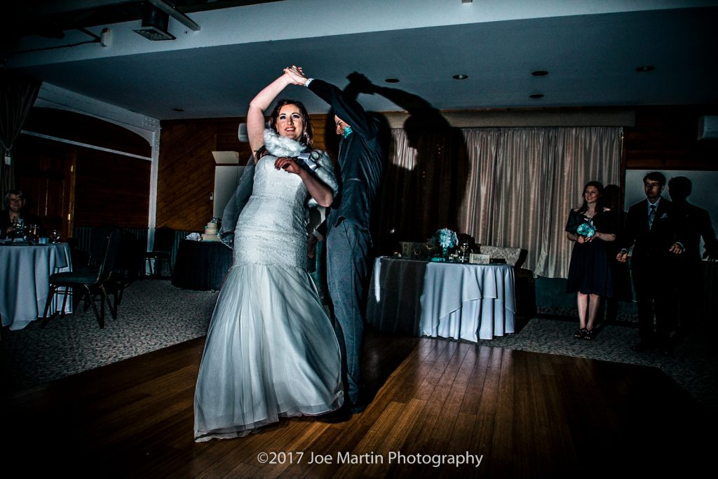 groom twirls the bride during the first dance