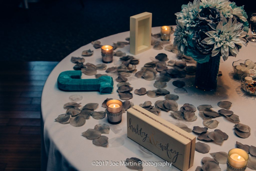 wedding details on the sweetheart table.