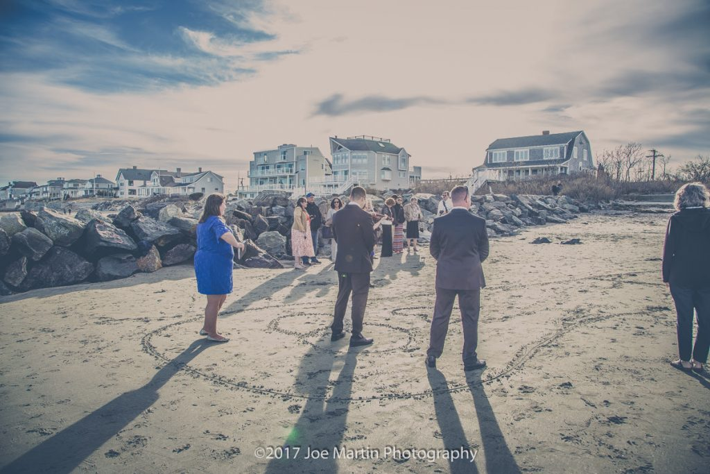 Groom waiting for the bride at a beach wedding