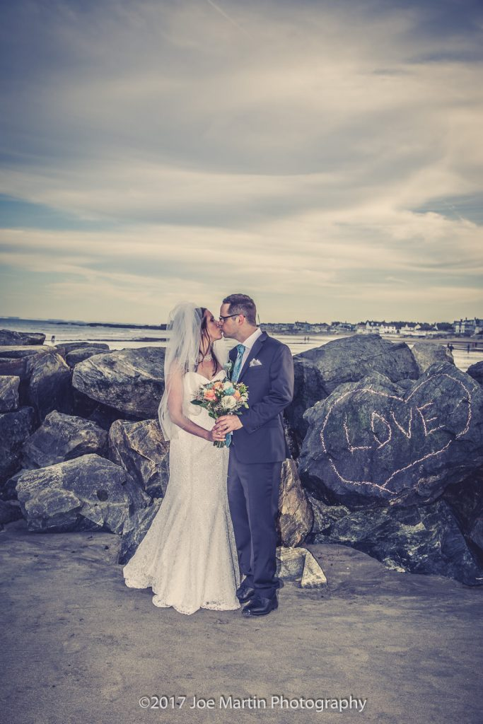 Young couple kissing in a bridal portrait