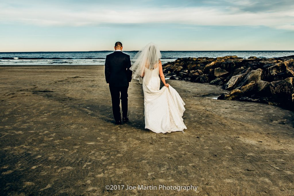 Fine art photo of a couple walking to the ocean