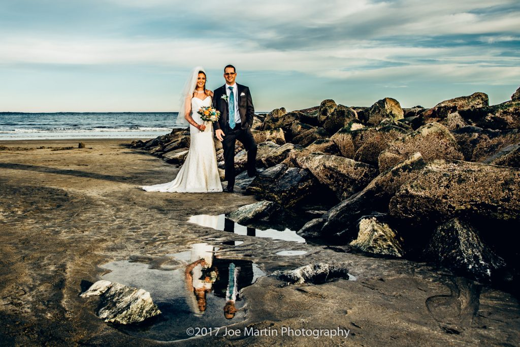 Wedding photo showing a reflection of a bride and groom at a beach wedding in NH