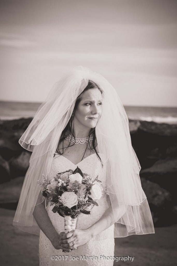 black and white photo of the bride looking off it to the distance