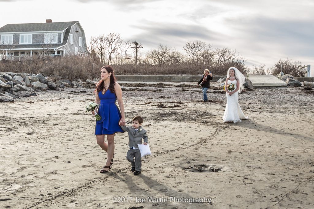 Here comes the bride at a Rye, Beach wedding In New Hampshire