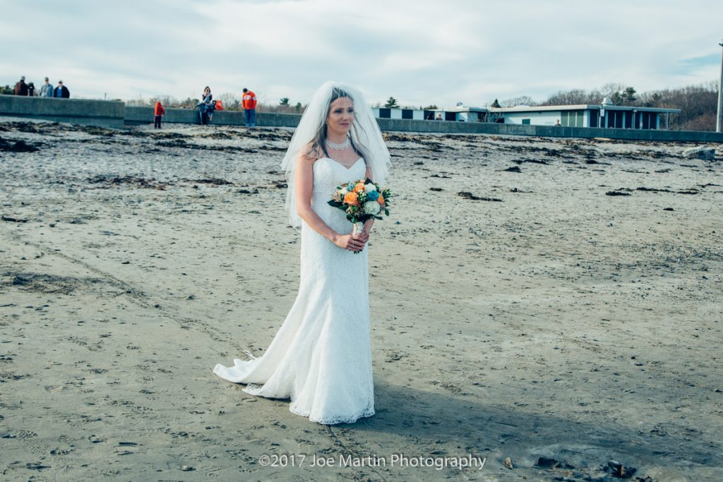 Bride walking on the beach