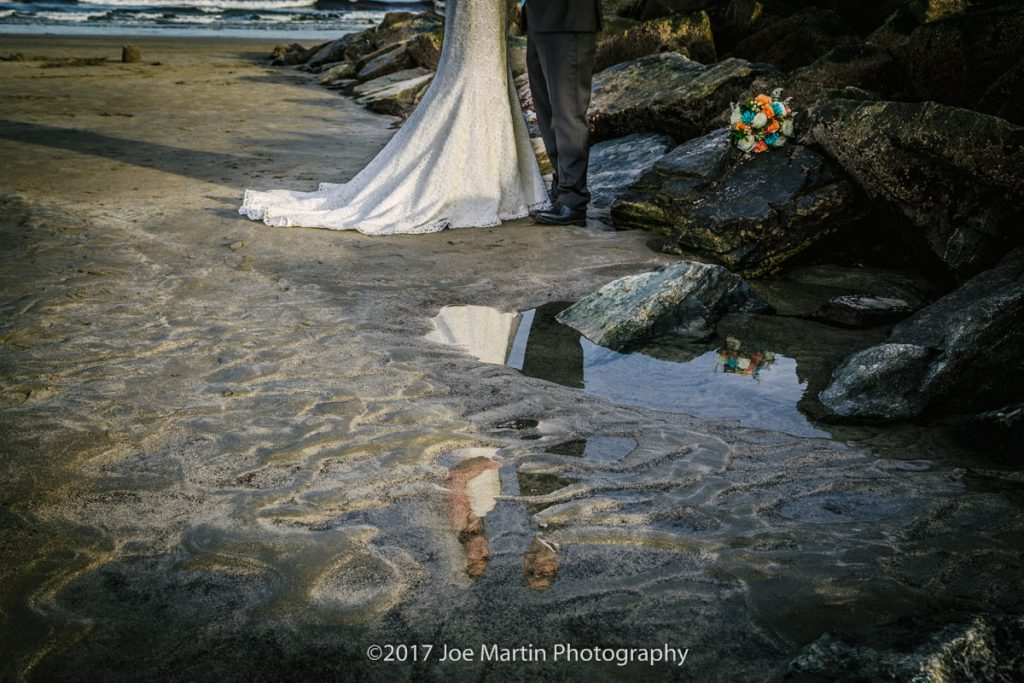 fine art crop of a wedding photo showing a bride and groom in a reflection
